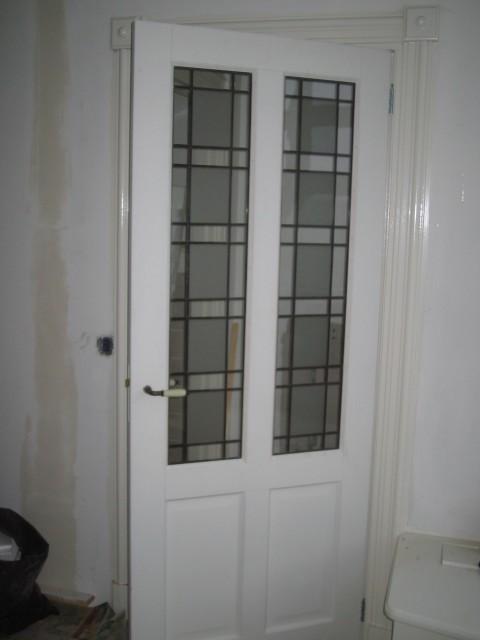 glas en lood deur van de hal in de woonkamer · albumelement